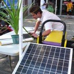 Chris Neidl sets up Solar One's photovoltaic panel demonstration